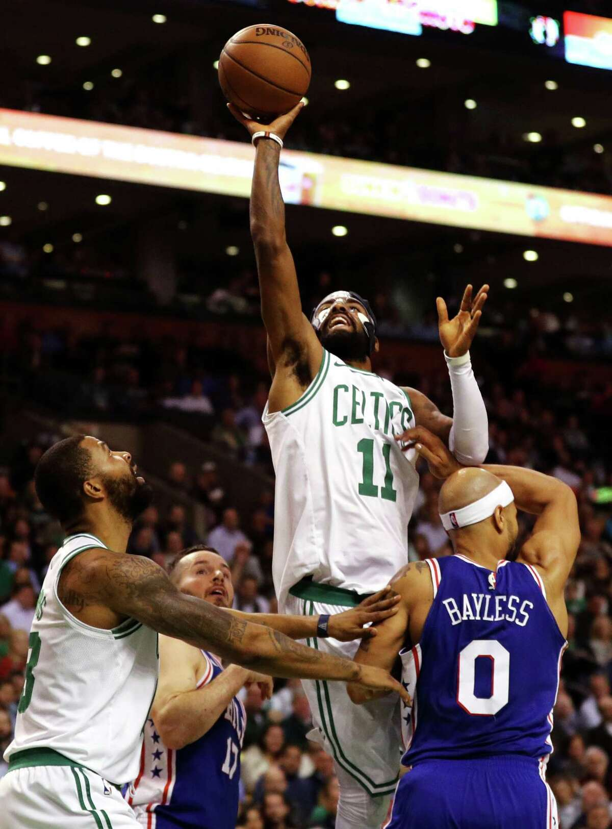 BOSTON, MA - NOVEMBER 30: Kyrie Irving #11 of the Boston Celtics takes a shot over Jerryd Bayless #0 of the Philadelphia 76ers during the second quarter at TD Garden on November 30, 2017 in Boston, Massachusetts.(Photo by Maddie Meyer/Getty Images) ORG XMIT: 775026965