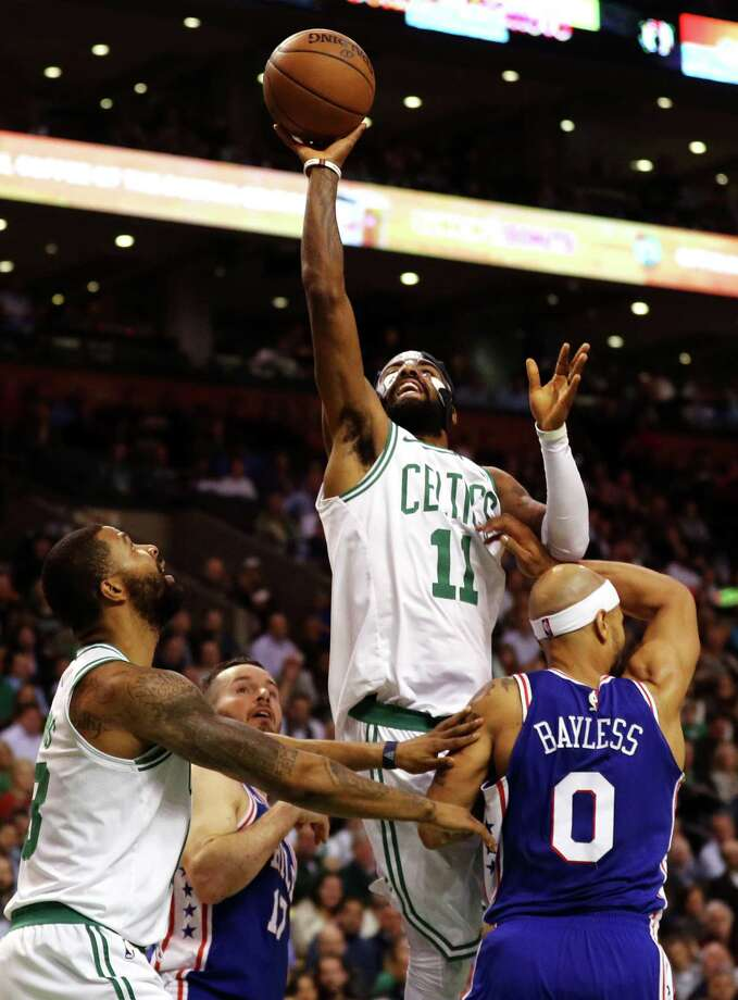 BOSTON, MA - NOVEMBER 30: Kyrie Irving #11 of the Boston Celtics takes a shot over Jerryd Bayless #0 of the Philadelphia 76ers during the second quarter at TD Garden on November 30, 2017 in Boston, Massachusetts.(Photo by Maddie Meyer/Getty Images) ORG XMIT: 775026965 Photo: Maddie Meyer / 2017 Getty Images