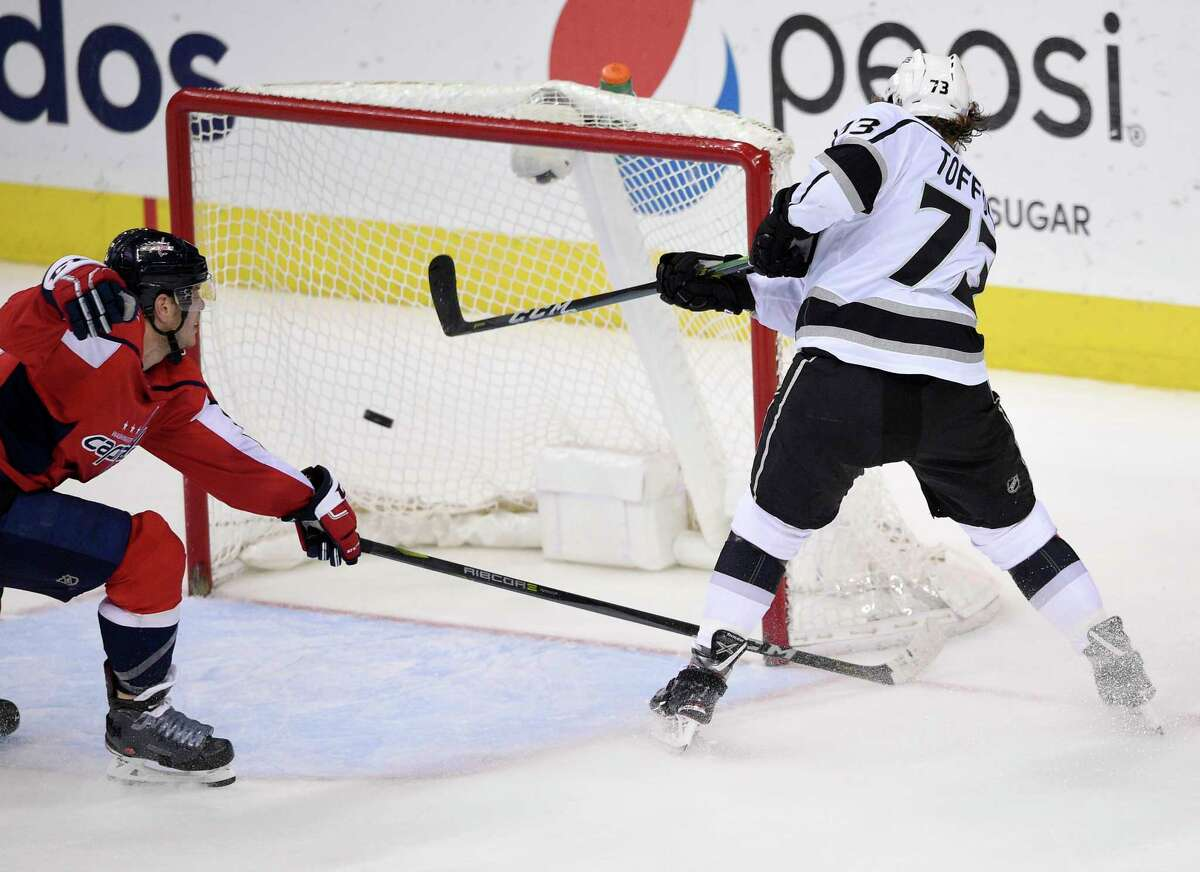 Los Angeles Kings center Tyler Toffoli (73) scores an empty-net goal against the Washington Capitals during the third period of an NHL hockey game, Thursday, Nov. 30, 2017, in Washington. The Kings won 5-2. (AP Photo/Nick Wass) ORG XMIT: VZN115