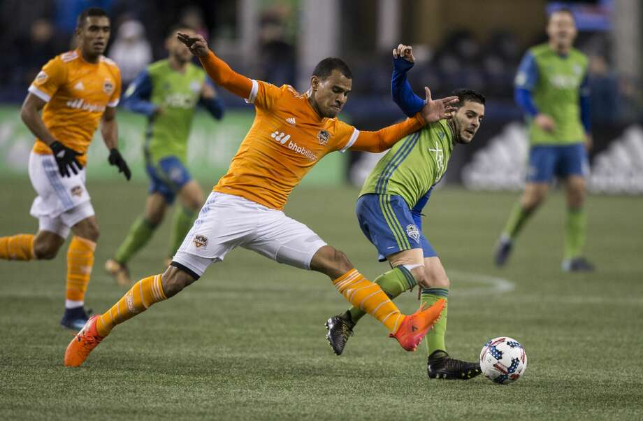 SEATTLE, WA - NOVEMBER 30: Juan Cabezas #5 of the Houston Dynamo and Victor Rodriguez #8 of the Seattle Sounders battle for the ball during the first half of the second leg of the MLS Western Conference Finals at CenturyLink Field on November 30, 2017 in Seattle, Washington. (Photo by Stephen Brashear/Getty Images) Photo: Stephen Brashear/Getty Images