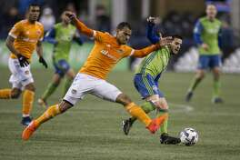 SEATTLE, WA - NOVEMBER 30: Juan Cabezas #5 of the Houston Dynamo and Victor Rodriguez #8 of the Seattle Sounders battle for the ball during the first half of the second leg of the MLS Western Conference Finals at CenturyLink Field on November 30, 2017 in Seattle, Washington. (Photo by Stephen Brashear/Getty Images)