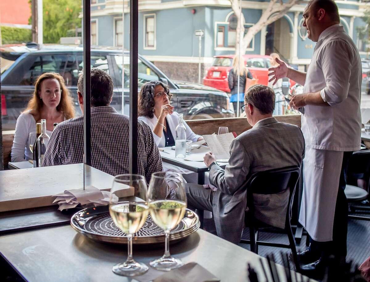 Diners enjoy dinner at Monsieur Benjamin in San Francisco, Calif. on Friday, August 29th, 2014.