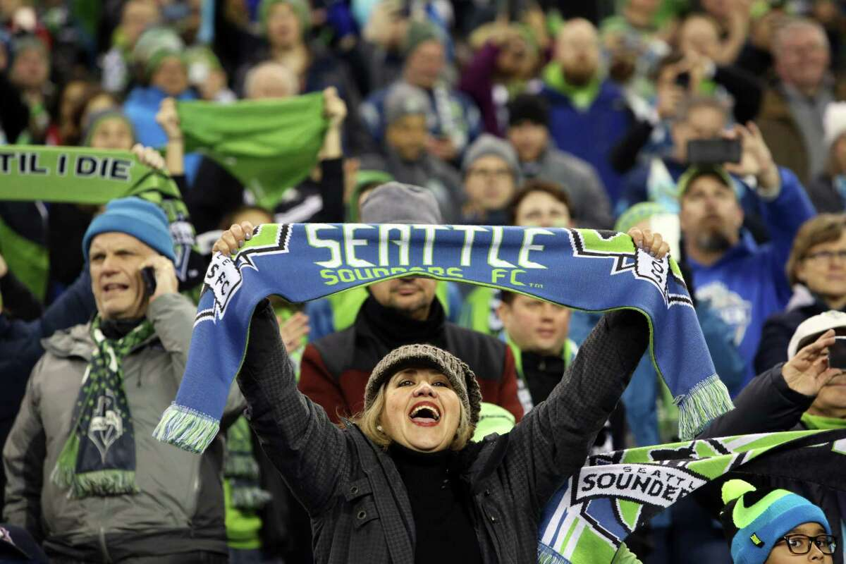 In this file photo, Fans cheer as the Seattle Sounders win the MLS Western Conference Finals second leg match, at CenturyLink Field in Seattle, Washington, on November 30, 2017. (Genna Martin/seattlepi.com)