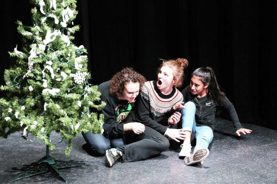 Three spiders, played by senior Sidney Underwood, junior Avery Bendele, and sophomore Aliyah Banda, get caught by the jolly guy, Santa Claus, while they are spinning their web in the Christmas tree. Photo: David Taylor