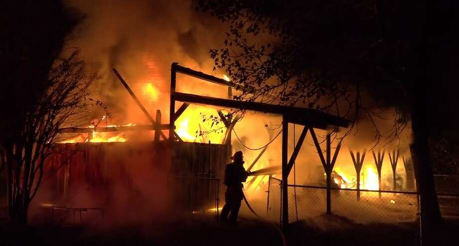 A barn fire late Thursday destroyed a number of vehicles and equipment in Montgomery County. Photo: Scott Engle / Montgomery County Police Reporter