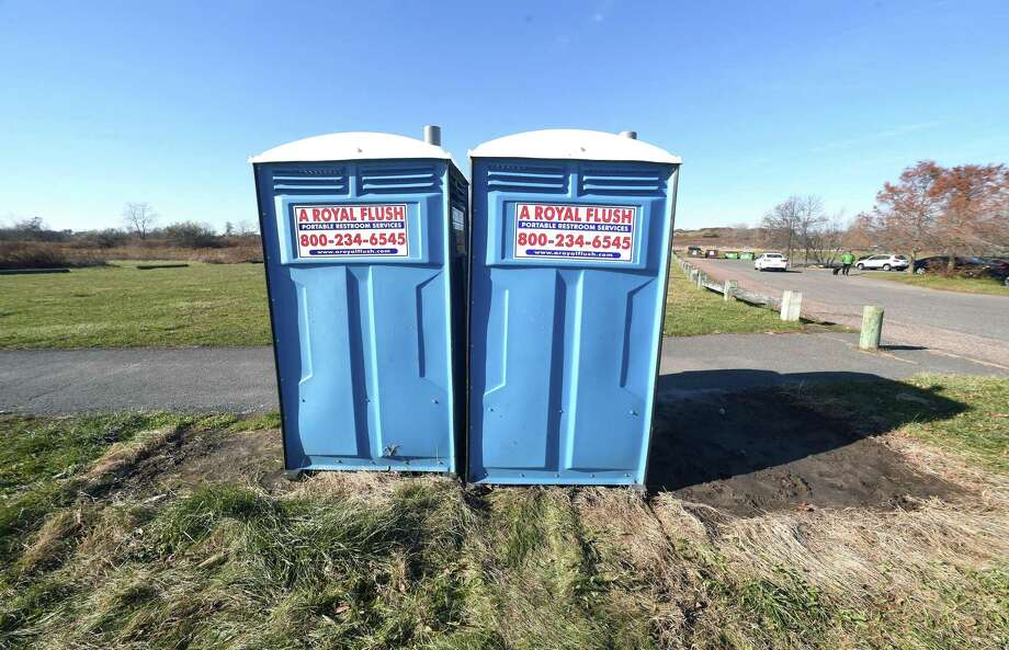 Portable toilets are positioned next to the parking lot at Silver Sands Beach State Park in Milford on November 28, 2017. Photo: Arnold Gold / Hearst Connecticut Media / New Haven Register