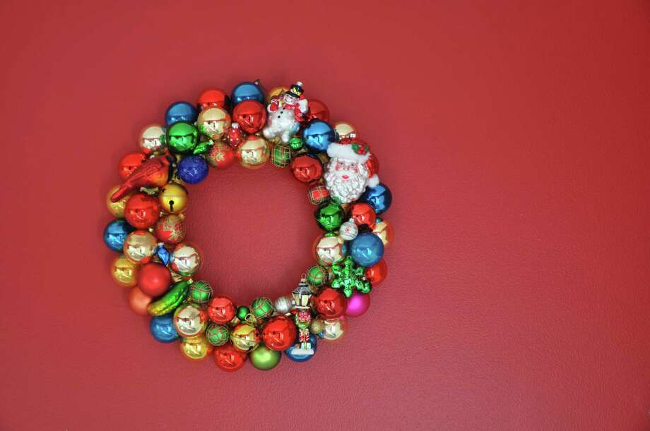 In an afternoon you can make this DIY ornament wreath using a few new bulbs along with old ones you don't put on your tree anymore. A few special ornaments, including the cardinal, Santa and snowman, stand out among the rest. Photo: Melissa Ward Aguilar