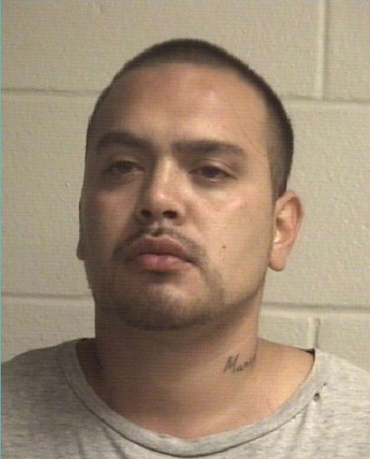 Ediberto Antonio DeLeon, 28, is charged with murder and nonnegligent manslaughter after he allegedly shot his wife's acquaintance on Friday, Dec. 1, 2017 in Alvin. Photo: Alvin Police Department