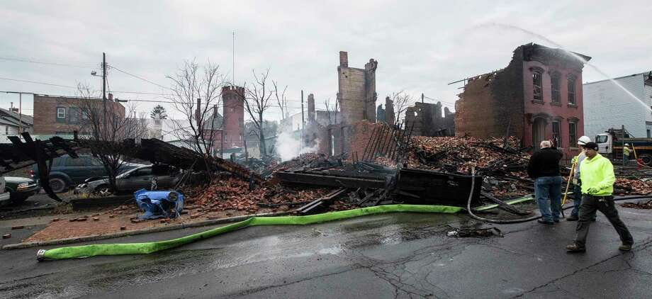 The scene of the fire looks like the remnants of a war zone  the fire the morning after a multi-alarm fire consumed three buildings and damaged at least 17 others on Remsen and surrounding streets Friday Dec 1, 2017 in Cohoes, NY.  (Skip Dickstein/ Times Union) Photo: SKIP DICKSTEIN, Albany Times Union / 20042291A