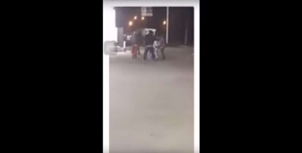 The graphic social media video was released by the Houston Police Department and appears to show the altercation prior to the shooting of Oscar Green, 47. The portion of the video showing Green's dead body lying on the pavement has been edited out by Chron.com.