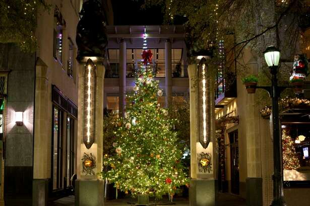 Holidays on Houston Street in San Antonio showcases a decorated Christmas tree in the courtyard of Bohanan's downtown and lights along Houston Street.