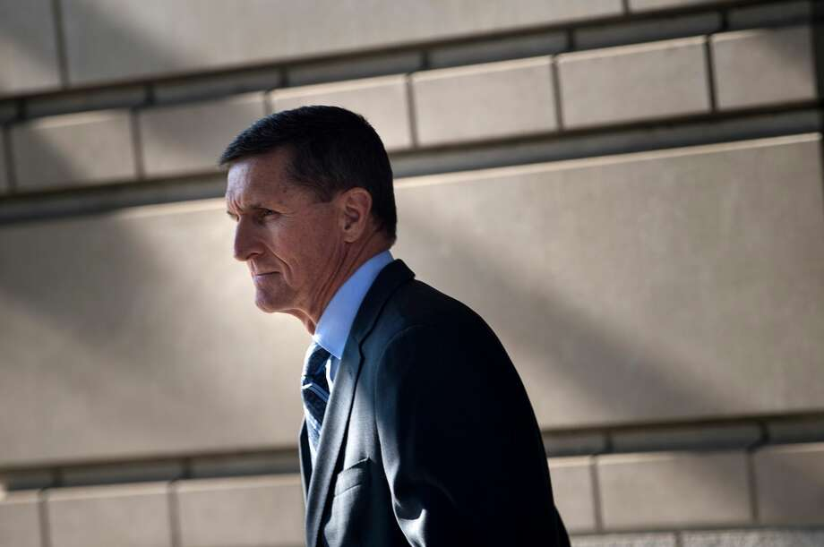 Gen. Michael Flynn, former national security adviser to US President Donald Trump, leaves Federal Court December 1, 2017 in Washington, DC. Donald Trump's former national security advisor Michael Flynn appeared in court Friday after being charged with lying over his Russian contacts, as part of the FBI's probe into possible collusion between the Trump campaign and Moscow.Ex-Trump aide Flynn says he recognizes his actions 'were wrong'. Photo: BRENDAN SMIALOWSKI/AFP/Getty Images