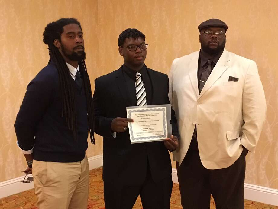 Hightower senior offensive tackle Anthony Williams was one of 25 elite football scholar-athletes honored Nov. 15 by the Touchdown Club of Houston. An award-winning film editor, Williams will attend and play football at Howard University. Photo: Jack Marrion