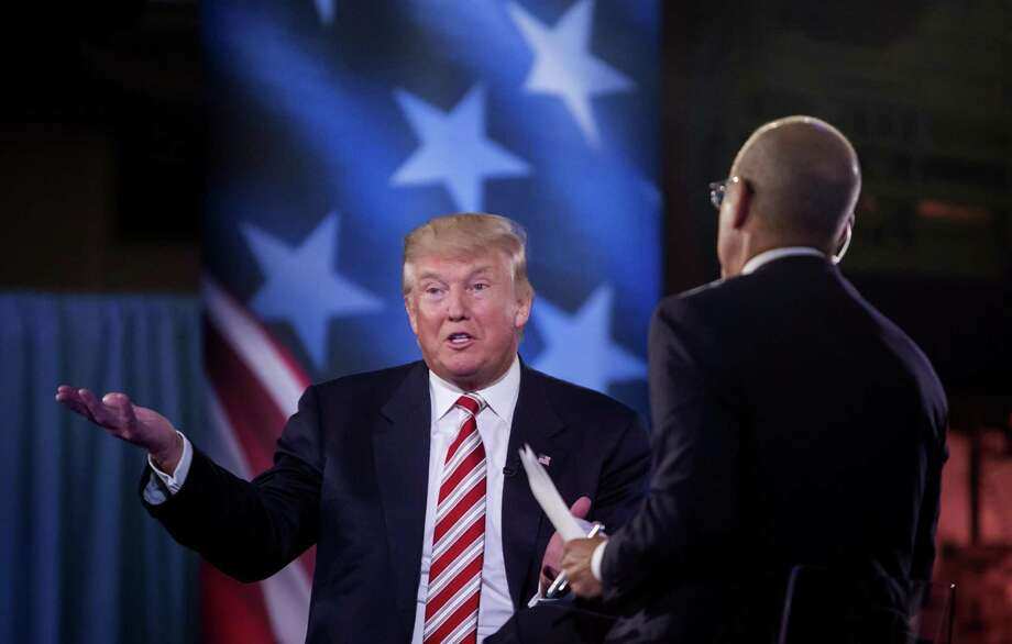 Host Matt Lauer from NBC listens as Donald Trump speaks at a forum on national security and veteransÕ issues at the Intrepid Sea, Air & Space Museum in New York, Sept. 7, 2016. In an event aboard the decommissioned aircraft carrier Intrepid, Lauer was lost at sea. Seemingly unprepared on military and foreign policy specifics, he performed like a soldier sent on a mission without ammunition, beginning with a disorganized offensive, ending in a humiliating retreat. (Eric Thayer/The New York Times) Photo: ERIC THAYER / NYT / NYTNS