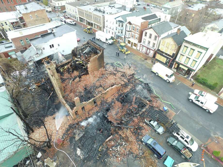 Nearly 30 buildings were destroyed or damaged by the powerful blaze that ripped through downtown Cohoes on Nov. 30, 2018. Click through the slideshow to see Remsen Street during the fire and then one year later. Photo: Lee Bormann / Albany County