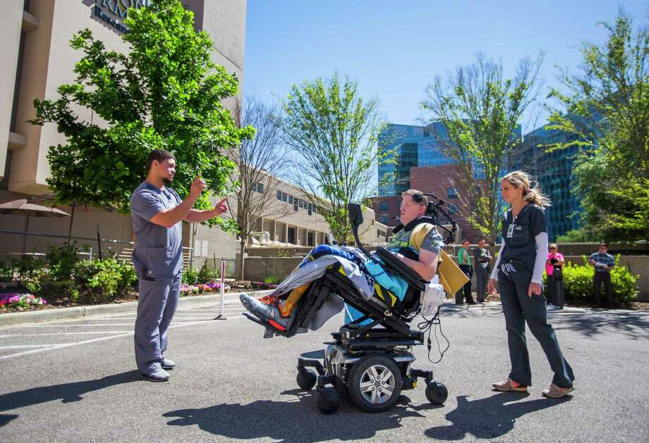Therapists direct Nick Tullier in the use of a motorized wheelchair controlled with head movements in TIRR Memorial Hermann. Photo: Mark Mulligan, Houston Chronicle / © 2017 Houston Chronicle