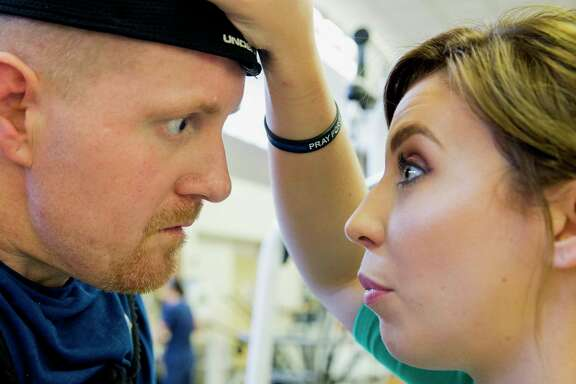 """""""Come on, Nick,"""" Danielle McNicoll whispers to her fiancé, Nick Tullier, encouraging him to keep taking steps inside the rehab gym at TIRR Memorial Hermann."""