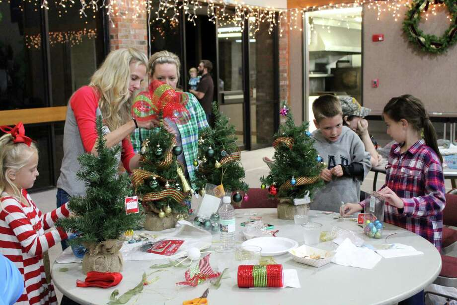 Families work together to decorate tabletop Christmas Trees for the Hope in the Forest initiative on Wednesday, Nov. 29 at First Presbyterian Church in Kingwood. Photo: Melanie Feuk