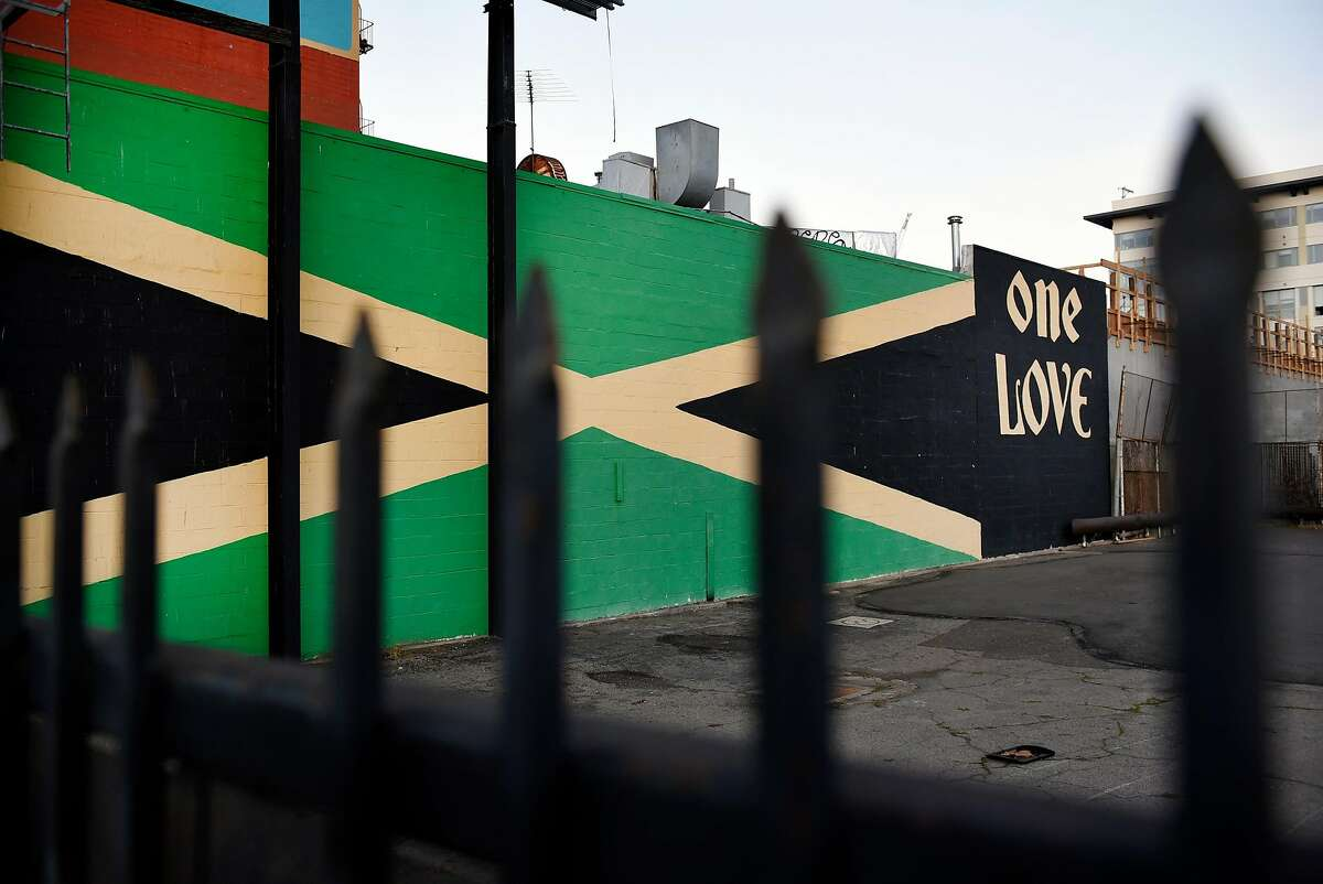 A mural of the Jamaican flag is seen on the side of Nigel Jones' Jamaican restaurant Kingston 11, in Oakland, CA, on Thursday November 30, 2017.
