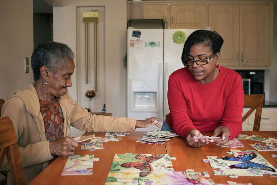 Alantris Muhammad said she found puzzles a helpful brain and dexterity exercise for her mom. Photo: Photo For The Washington Post By Alyssa Schukar. / Alyssa Schukar for The Washington Post.