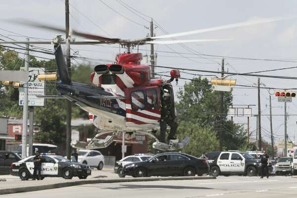 Houston Police Chief Art Acevedo, Fire Chief Samuel Pena and Houston's mayor Sylvester Turner survey damage of Hurricane Harvey from a helicopter Thursday, Aug. 31, 2017, in Houston.