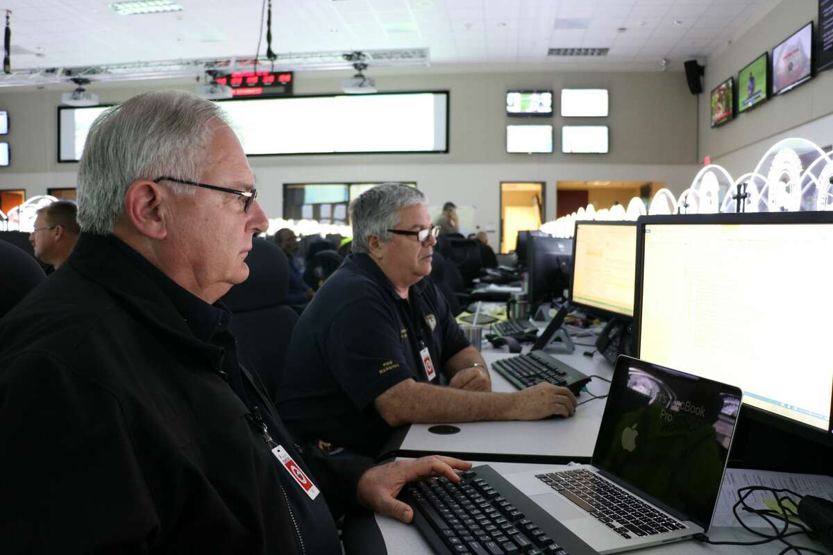 Bob Royall works to coordinate high water rescues during Hurricane Harvey.