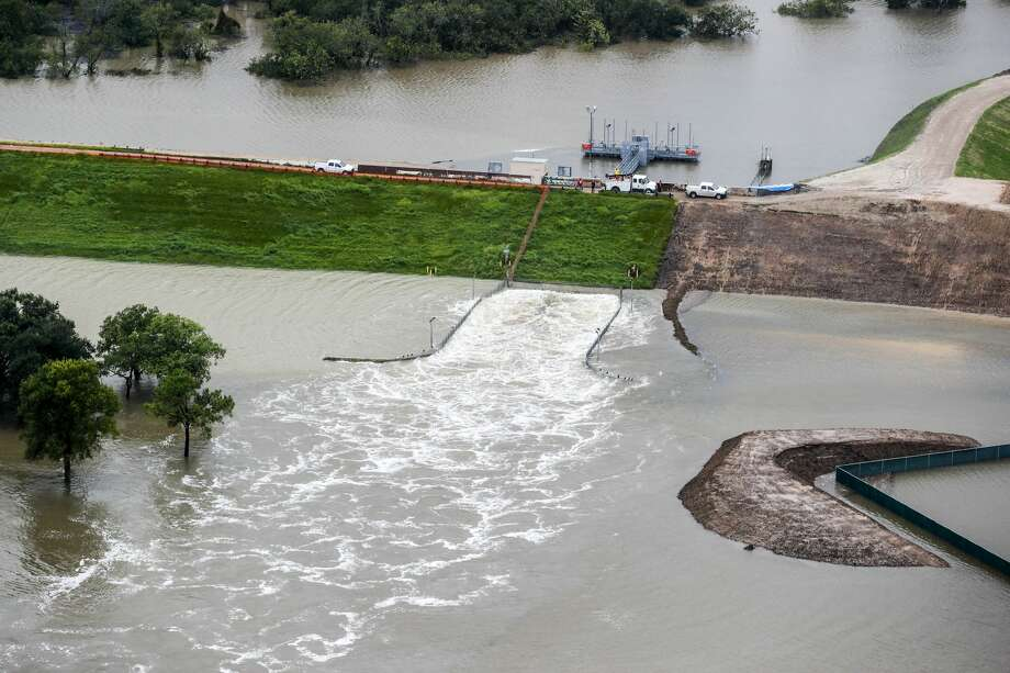 "The Barker dam, shown here during Hurricane Harvey, was listed as ""unsafe"" by the Army Corps of Engineers in 2009. Photo: Brett Coomer, Houston Chronicle"