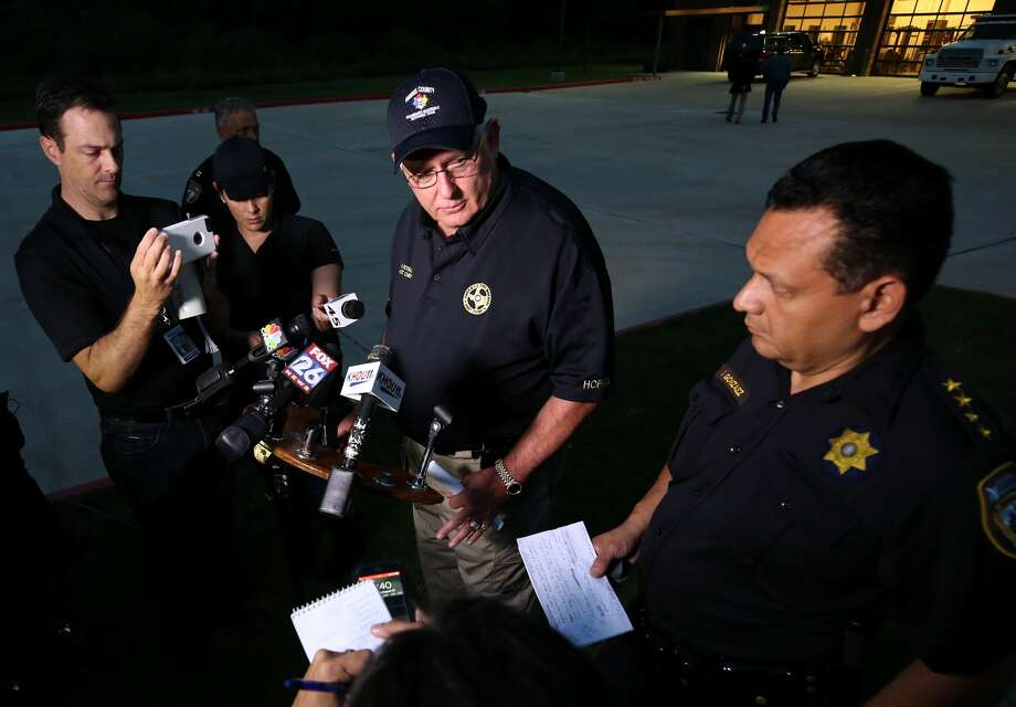 Harris County Fire Marshal Assistant Chief Bob Royall, center, and Harris County Sheriff Ed Gonzalez outside the Crosby Fire Department Thursday, Aug. 31, 2017, in Crosby, Texas. Photo: Godofredo A. Vasquez/Houston Chronicle