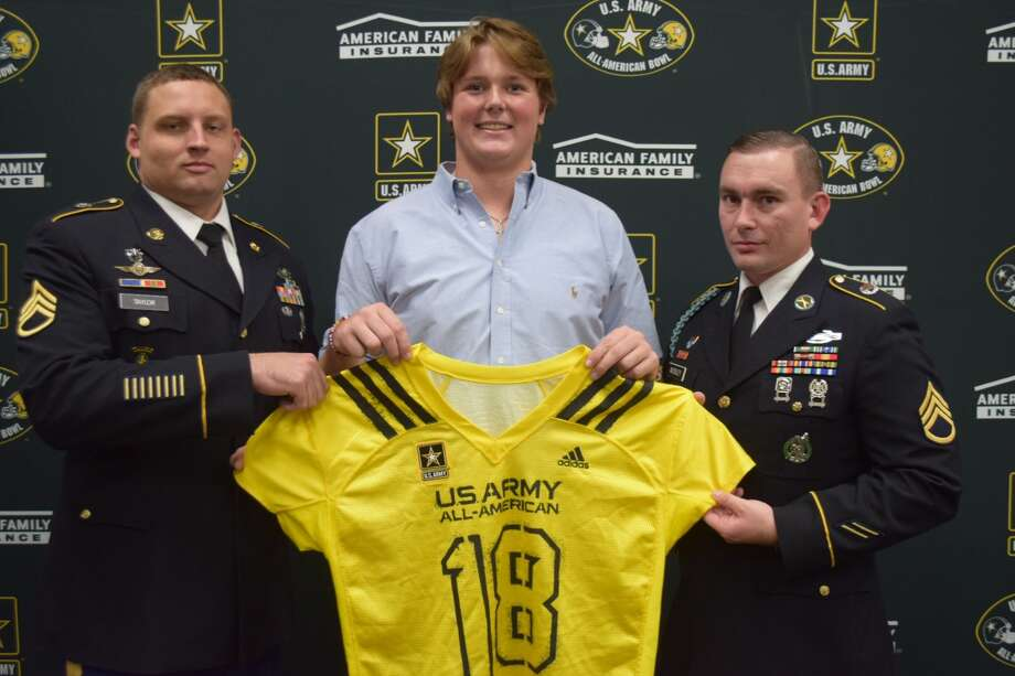 Cypress Ranch offensive lineman Colten Blanton was presented with a U.S. Army All-American Bowl jersey as part of the event's Selection Tour. Blanton will play for the West squad Jan. 6 at the Alamodome in San Antonio. Pictured from left are SSG Mosley, Colten Blanton and SSG Taylor. Photo: All American Games