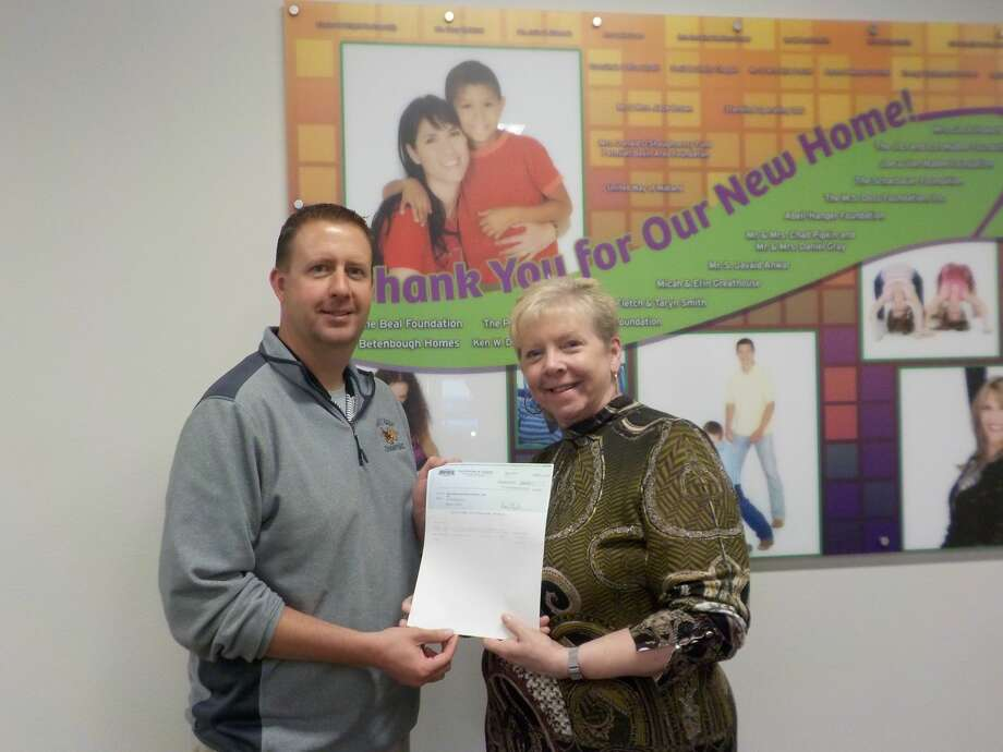 Jamie Richardson of the Midland RockHounds presents a donation to Big Brothers Big Sisters of Midand resource development director Molly Murphy. Photo: Courtesy Photo