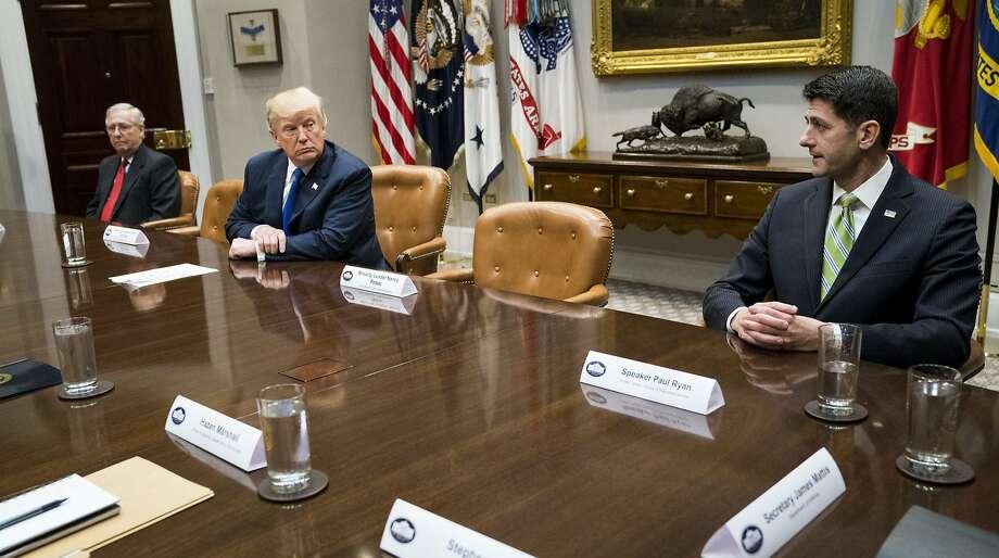 House Speaker Paul Ryan (right) wants to set a new government shutdown deadline of Dec. 22. Photo: DOUG MILLS, NYT