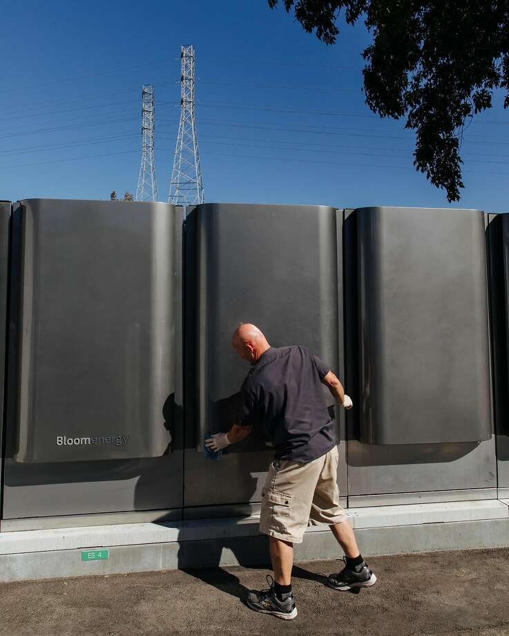Randy Eoff, a manufacturing specialist, cleans off the latest model of fuel cell generators at Bloom Energy in Sunnyvale. The company will install generators using fuel cells like the one below a dozen data centers. Photo: PETER PRATO, NYT