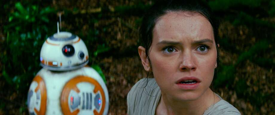 "BB-8 and Rey (Daisy Ridley) in a scene from ""Star Wars: The Force Awakens."" Photo: Courtesy, Lucasfilm Ltd."