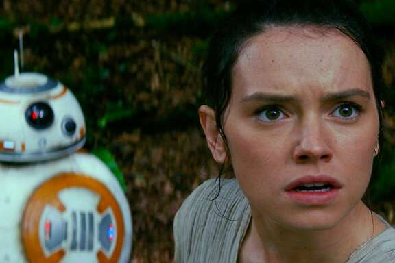 """BB-8 and Rey (Daisy Ridley) in a scene from """"Star Wars: The Force Awakens."""" Star Wars: The Force Awakens  L to R: BB-8 and Rey (Daisy Ridley)  Ph: Film Frame  © 2014 Lucasfilm Ltd. & TM. All Right Reserved."""