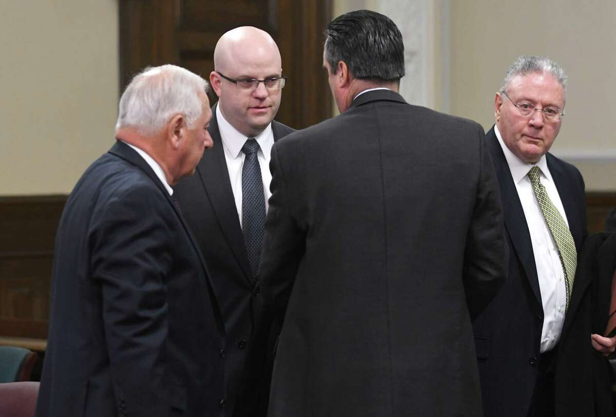 Rensselaer County District Attorney Joel Abelove, second from left, talks to attorneys after Columbia County Court Judge Jonathan Nichols indicted him on two official misconduct charges and one charge of 1st degree perjury for his handling of an April 2016 fatal shooting by Troy Police Sgt. Randall French of Edson Thevenin at the Rensselaer County Court House on Friday, Dec. 1, 2017 in Troy, N.Y. (Lori Van Buren / Times Union)