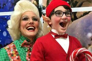 """Mrs. Claus (Shelley Marsh Poggio, of Durham) oversees an elf named Tidings (Sebastian Bianchine, of New Haven) in Pantochino's new holiday musical, """"School for Elves,"""" in Milford through Dec. 17."""