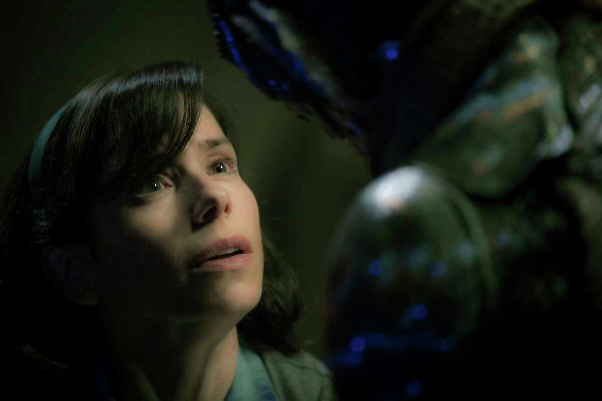 """This image released by Fox Searchlight Pictures shows Sally Hawkins, left, and Doug Jones in a scene from the film """"The Shape of Water."""" (Kerry Hayes/Fox Searchlight Pictures via AP)"""
