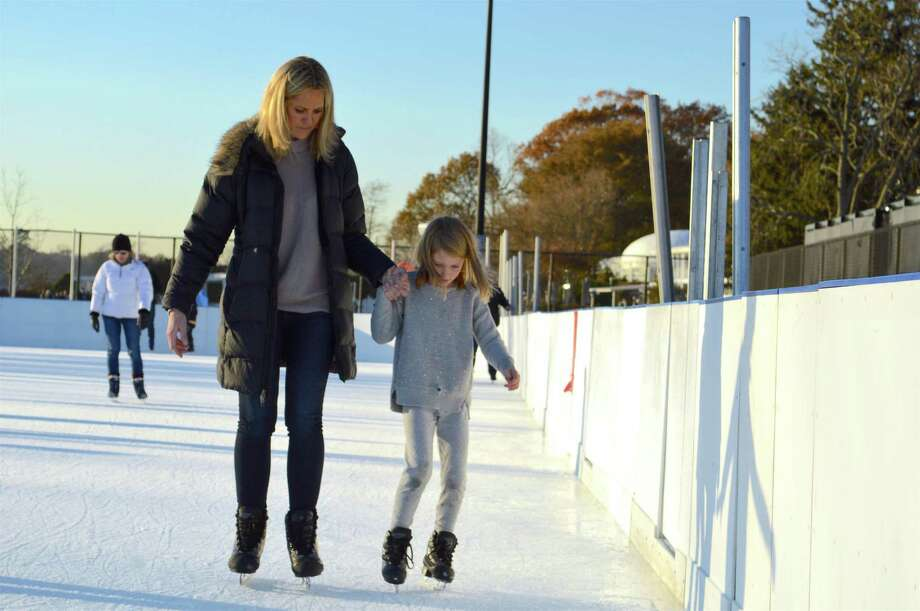 Liz Grennan of New Canaan and her daughter Lucy, 6, skate together at the opening day at the Westport P.A.L. Rink at Longshore, Friday, Nov. 24, 2017, in Westport, Conn. Photo: Jarret Liotta / For Hearst Connecticut Media / Westport News Freelance