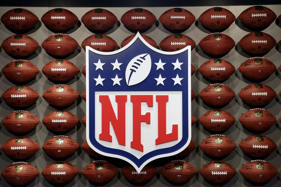 """An NFL logo is displayed at the opening of """"NFL Experience"""" in Times Square, New York, Thursday, Nov. 30, 2017. (AP Photo/Seth Wenig) Photo: Seth Wenig/Associated Press"""