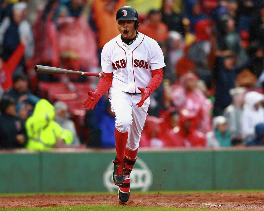 Mookie Betts of the Boston Red Sox flips his Axe Handle bat on Sept. 30