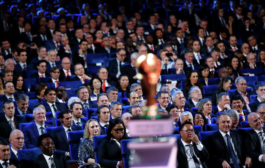 Brazilian soccer legend Pele, bottom second left, FIFA president Gianni Infantino, bottom right, and Vitaly Mutko, Russian Federation Deputy Prime Minister & Local Organising Committee Chairman, bottom second right, watch the 2018 soccer World Cup draw in the Kremlin in Moscow, Friday Dec. 1, 2017. (AP Photo/Alexander Zemlianichenko) Photo: Alexander Zemlianichenko, STF / Copyright 2017 The Associated Press. All rights reserved.