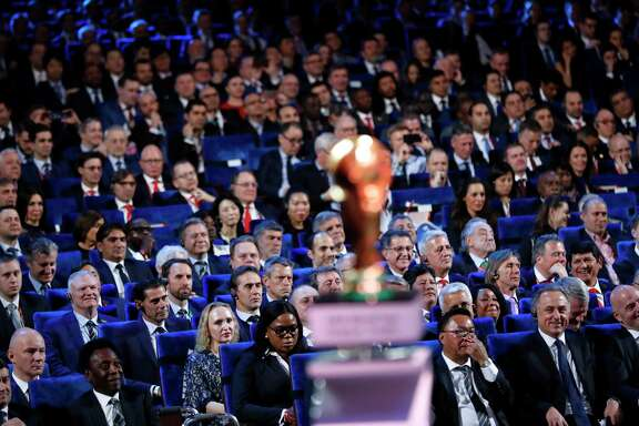 Brazilian soccer legend Pele, bottom second left, FIFA president Gianni Infantino, bottom right, and Vitaly Mutko, Russian Federation Deputy Prime Minister & Local Organising Committee Chairman, bottom second right, watch the 2018 soccer World Cup draw in the Kremlin in Moscow, Friday Dec. 1, 2017. (AP Photo/Alexander Zemlianichenko)