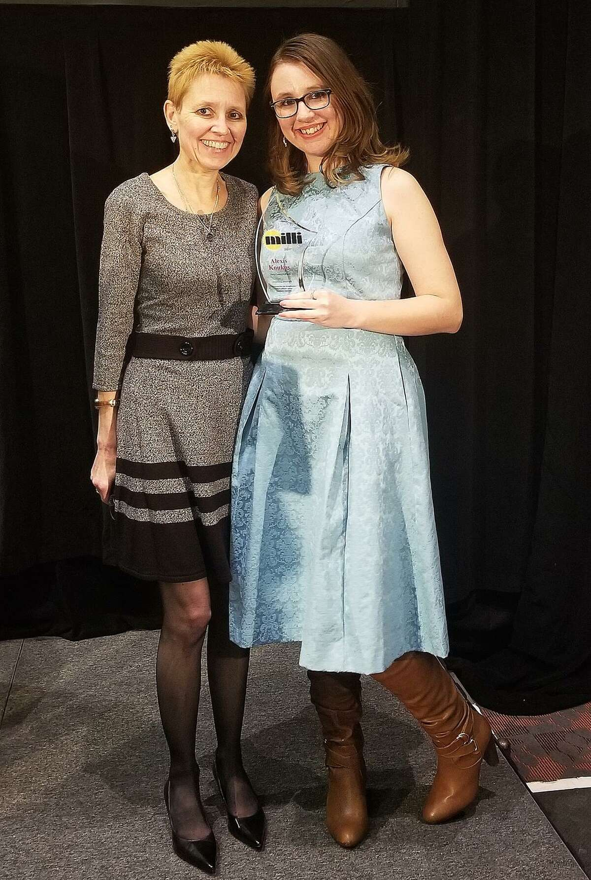 Alexis Koukos stands with her mother Pamela Brown as she accepts a Millennial Award from Westfair Communications on Nov. 14, 2017, in White Plains, N.Y.