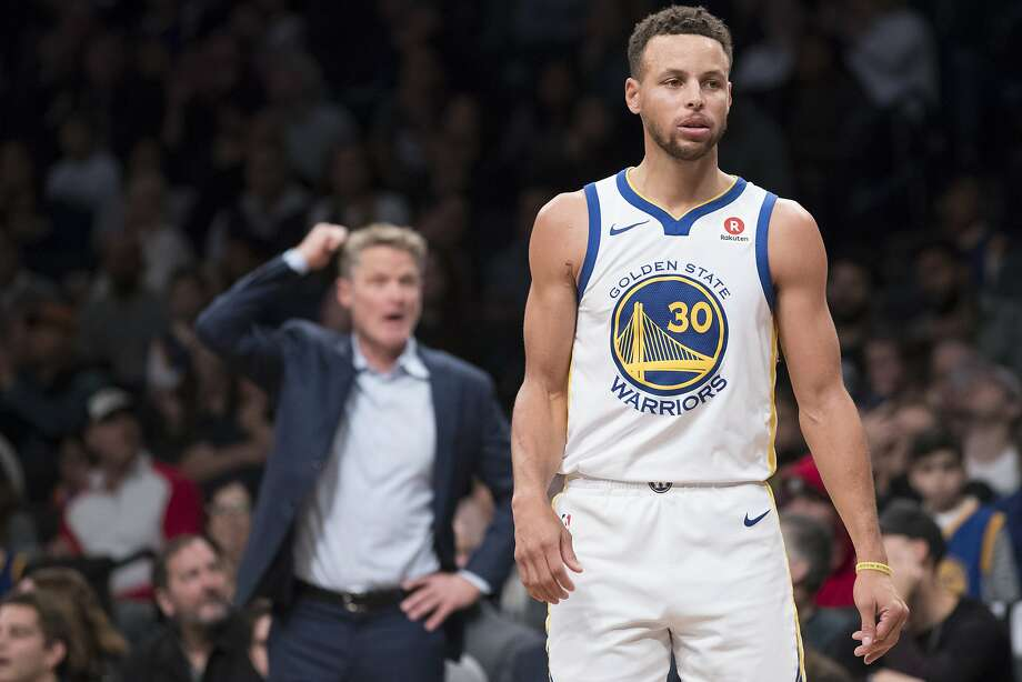 Golden State Warriors guard Stephen Curry looks on as head coach Steve Kerr gestures during the second half of an NBA basketball game against the Brooklyn Nets, Sunday, Nov. 19, 2017, in New York. The Warriors won 118 - 111. (AP Photo/Mary Altaffer) Photo: Mary Altaffer, Associated Press