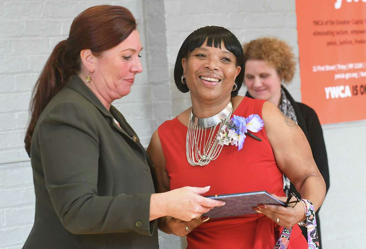 YWCA-GCR Board President Lisa Lagon, left, presents Wilda Strong with her certificate at a graduation for the YWCA's 12-week Jamison-Rounds Ready for Work Program at the YWCA of the Greater Capital Region on Friday, Dec. 1, 2017 in Troy, N.Y. The program helps women learn employment skills to secure jobs or advance to higher education and break down barriers women face when trying to get jobs. (Lori Van Buren / Times Union)