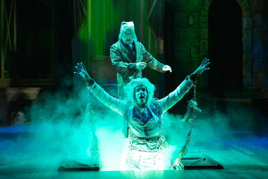 """Michael Ray Wisely (top), who is playing Ebenezer Scrooge for the third year in a row, and Jeff Draper in Center REPertory Company's """"A Christmas Carol."""" Photo: Kevin Berne, Center REPertory Company"""