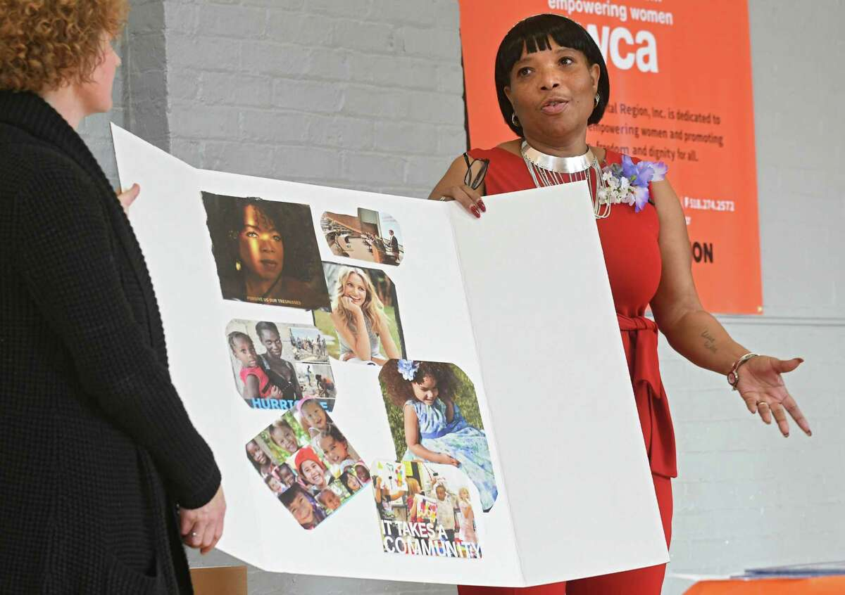 Wilda Strong talks about her goal board at a graduation for the YWCA's 12-week Jamison-Rounds Ready for Work Program at the YWCA of the Greater Capital Region on Friday, Dec. 1, 2017 in Troy, N.Y. The program helps women learn employment skills to secure jobs or advance to higher education and break down barriers women face when trying to get jobs. (Lori Van Buren / Times Union)