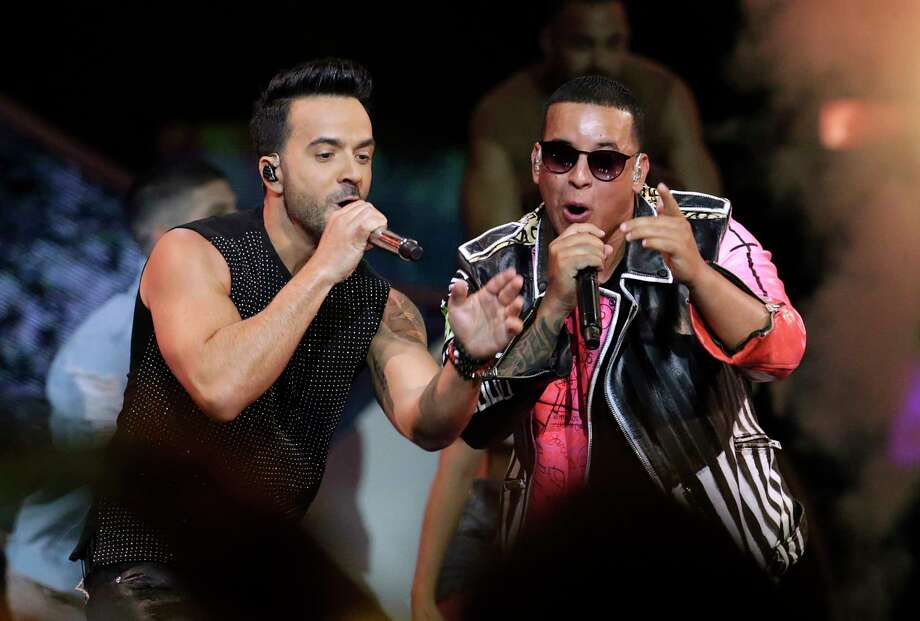"FILE - In this April 27, 2017, file photo, singers Luis Fonsi, left, and Daddy Yankee perform during the Latin Billboard Awards in Coral Gables, Fla. Despacito,"" Fonsi's mega-hit with Daddy Yankee, is nominated for several Grammy Awards including record of the year, song of the year and best pop duo/group performance. The 60th Annual Grammy Awards will air on CBS, Sunday, Jan. 28, 2018 in New York. (AP Photo/Lynne Sladky, File) Photo: Lynne Sladky, STF / Copyright 2017 The Associated Press. All rights reserved."