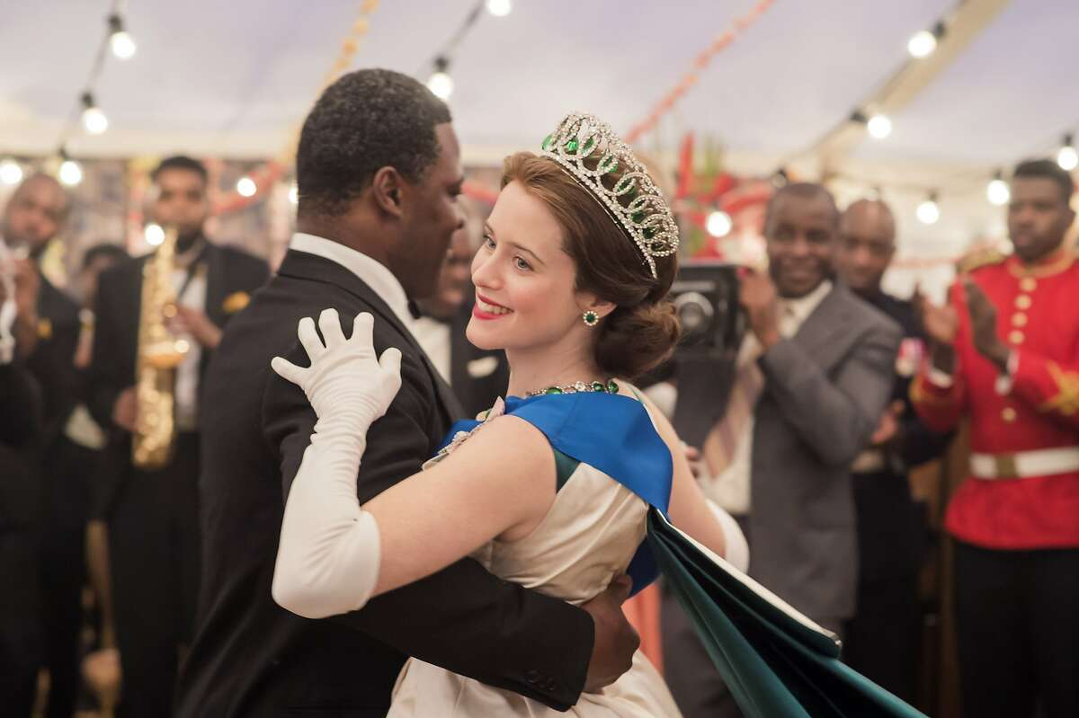 """Queen Elizabeth (Claire Foy) dances with Dr. Kwame Nkrumah (Danny Sapani) in the second season of """"The Crown"""" on Netflix"""