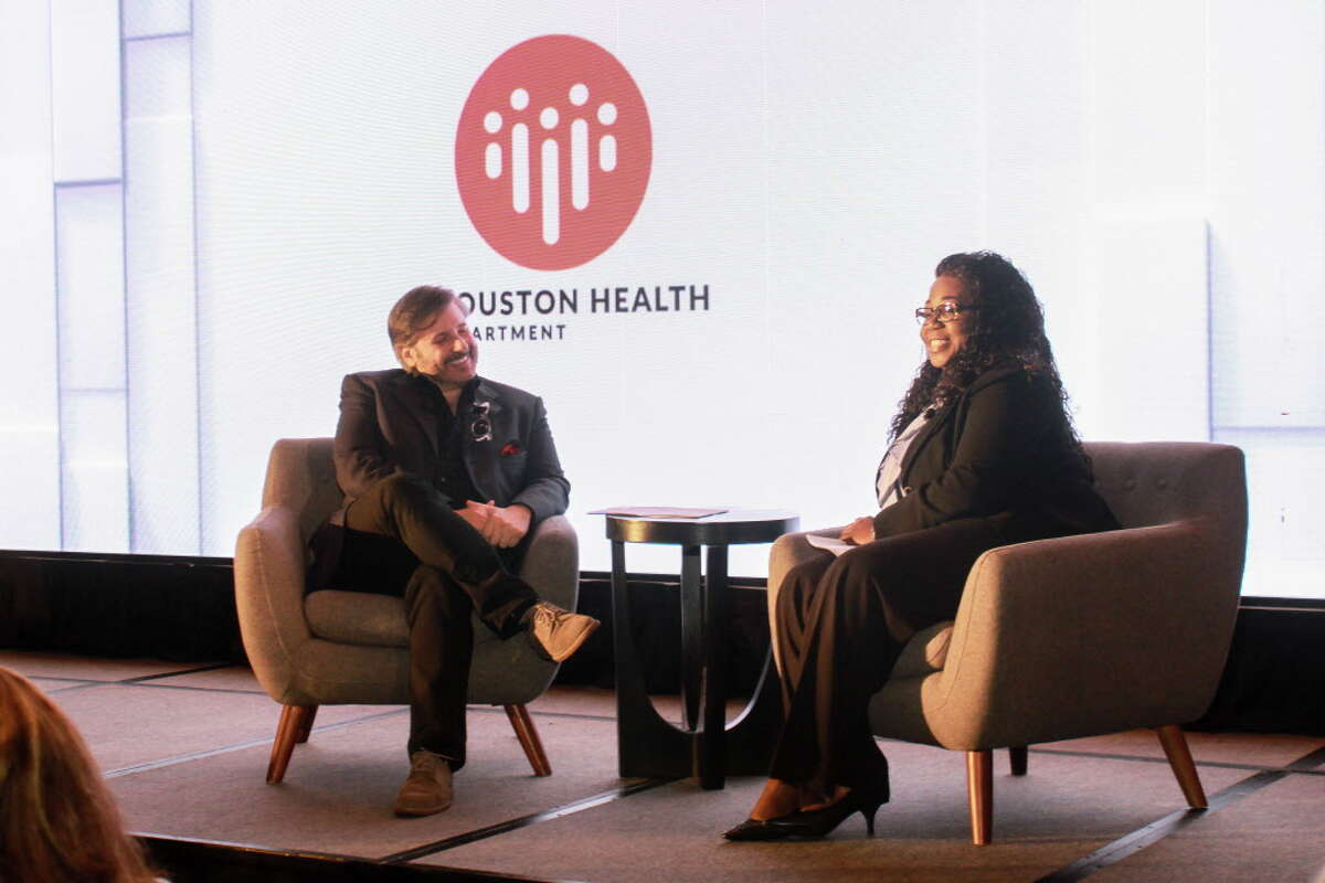 Ernie Manouse interviewing Marlene McNeese at the World Aids Day luncheon at the Hilton Post Oak.